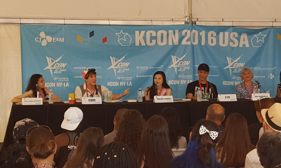 Photo of people talking about kcon